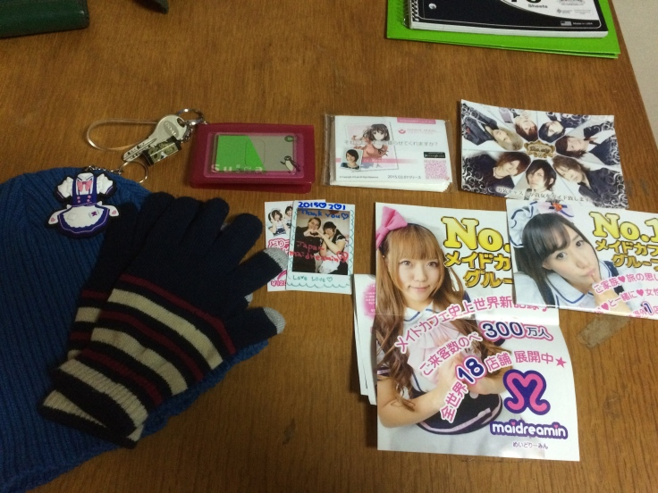Things I got today. My hat and gloves, my rail pass and rail pass sleeve, the cutest pack of tissues I've ever seen, my picture at Maidreamin, and the millions of fliers for other maid cafes I collected. At the top, you can see the one for the host club. R ended up doing most of the talking when we greeted the host, since I hardly speak any Japanese.